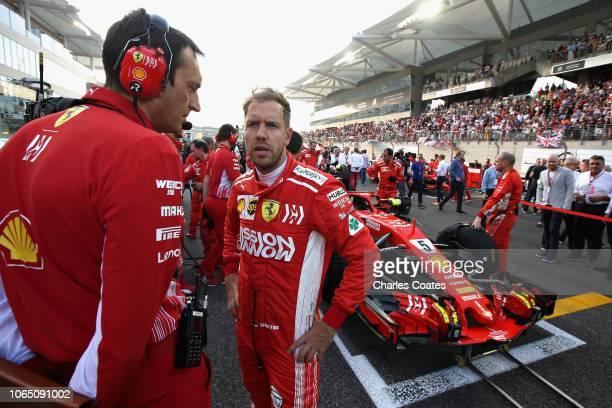 Sebastian Vettel of Germany and Ferrari prepares to drive on the grid before the Abu Dhabi Formula One Grand Prix at Yas Marina Circuit on November...