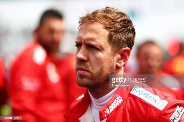Sebastian Vettel of Germany and Ferrari prepares to drive on the grid before the F1 Grand Prix of Mexico at Autodromo Hermanos Rodriguez on October...