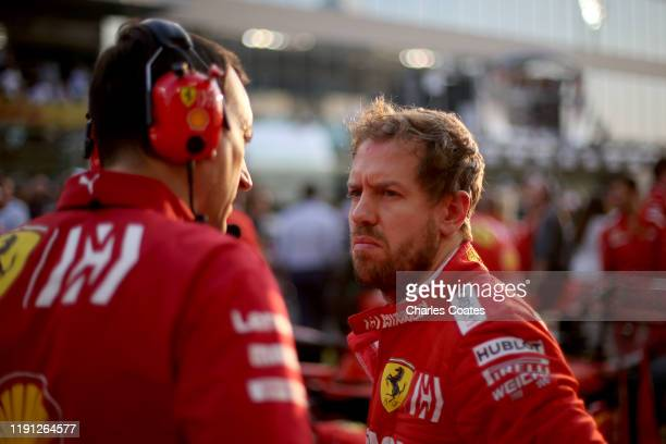 Sebastian Vettel of Germany and Ferrari prepares to drive on the grid before the F1 Grand Prix of Abu Dhabi at Yas Marina Circuit on December 01,...
