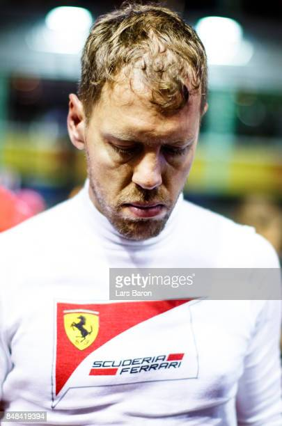 Sebastian Vettel of Germany and Ferrari prepares to drive on the grid before the Formula One Grand Prix of Singapore at Marina Bay Street Circuit on...