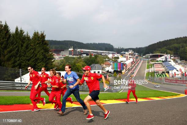Sebastian Vettel of Germany and Ferrari runs up the hill at Eau Rouge - Raidillon on track during previews ahead of the F1 Grand Prix of Belgium at...