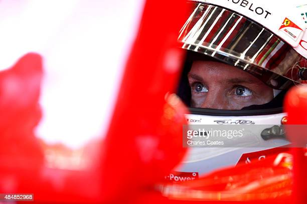 Sebastian Vettel of Germany and Ferrari sits in his car in the garage during final practice for the Formula One Grand Prix of Belgium at Circuit de...