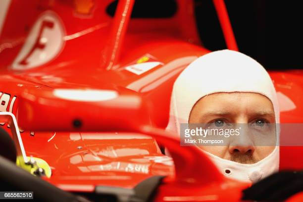 Sebastian Vettel of Germany and Ferrari sits in his car in the garage during practice for the Formula One Grand Prix of China at Shanghai...