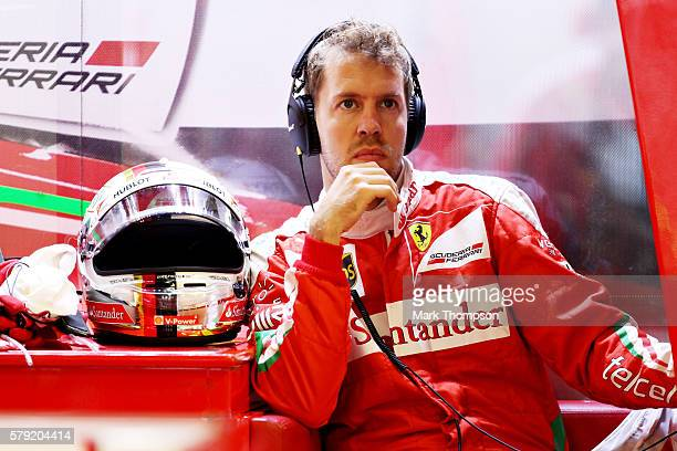 Sebastian Vettel of Germany and Ferrari sits in his garage during qualifying for the Formula One Grand Prix of Hungary at Hungaroring on July 23 2016...