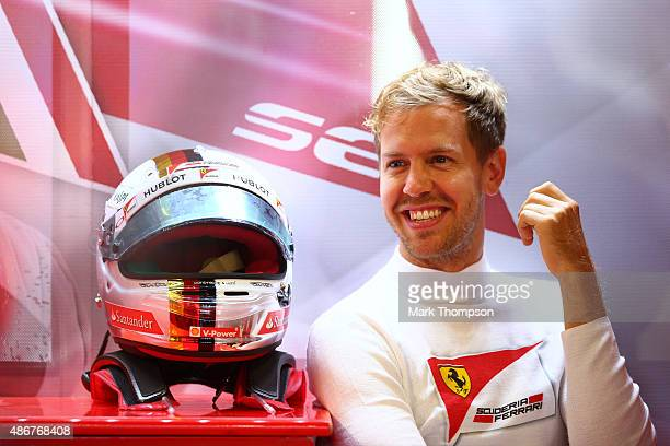 Sebastian Vettel of Germany and Ferrari smiles as he sits in the garage during final practice for the Formula One Grand Prix of Italy at Autodromo di...