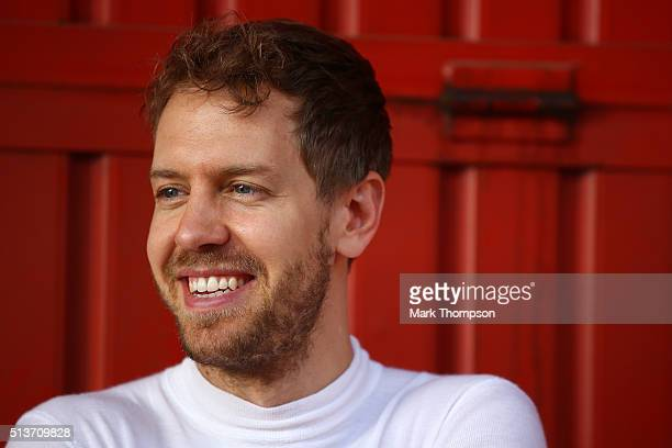 Sebastian Vettel of Germany and Ferrari smiles outside the garage during day four of F1 winter testing at Circuit de Catalunya on March 4 2016 in...