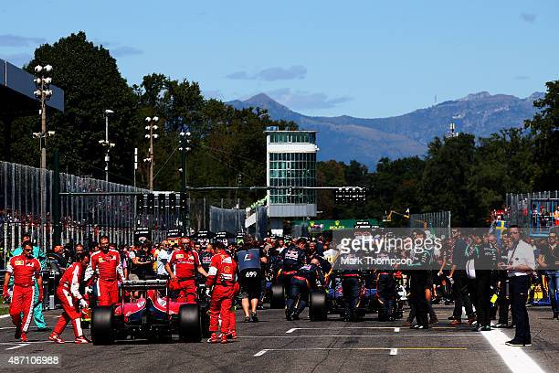Sebastian Vettel of Germany and Ferrari stops at the back of the grid as the cars are pushed onto the grid before the Formula One Grand Prix of Italy...