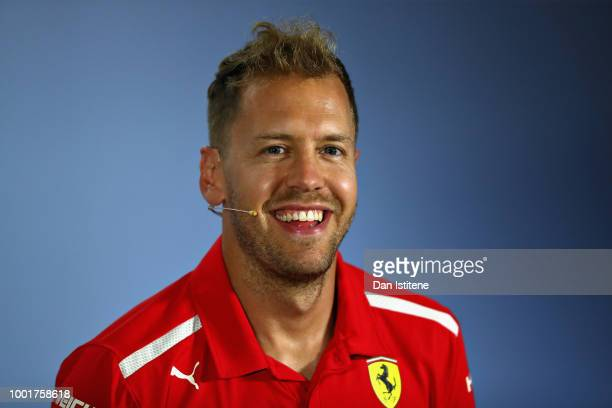 Sebastian Vettel of Germany and Ferrari talks in the Drivers Press Conference during previews ahead of the Formula One Grand Prix of Germany at...