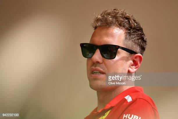 Sebastian Vettel of Germany and Ferrari talks in the Paddock during previews ahead of the Bahrain Formula One Grand Prix at Bahrain International...