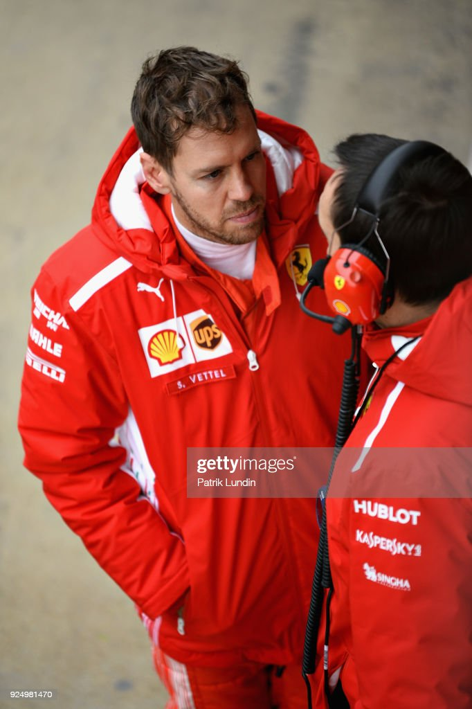Sebastian Vettel of Germany and Ferrari talks with an engineer in the Pitlane during day two of F1 Winter Testing at Circuit de Catalunya on February 27, 2018 in Montmelo, Spain.