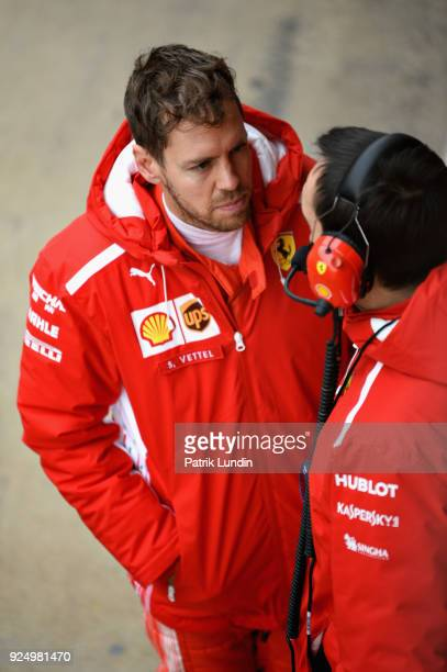 Sebastian Vettel of Germany and Ferrari talks with an engineer in the Pitlane during day two of F1 Winter Testing at Circuit de Catalunya on February...