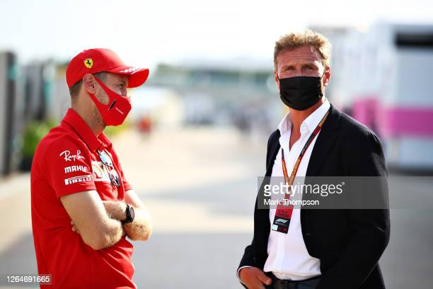 Sebastian Vettel of Germany and Ferrari talks with David Coulthard in the Paddock after qualifying for the F1 70th Anniversary Grand Prix at...