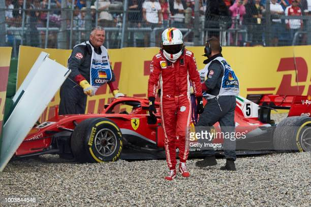 Sebastian Vettel of Germany and Ferrari walks from his car after crashing during the Formula One Grand Prix of Germany at Hockenheimring on July 22...