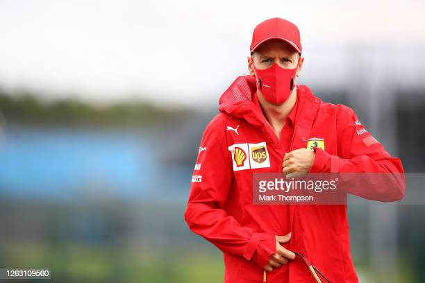 Sebastian Vettel of Germany and Ferrari walks in the Paddock before final practice for the F1 Grand Prix of Great Britain at Silverstone on August...