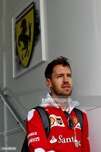 Sebastian Vettel of Germany and Ferrari walks in the Paddock before practice for the Formula One Grand Prix of Great Britain at Silverstone on July 8...