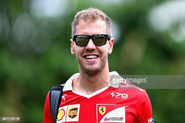 Sebastian Vettel of Germany and Ferrari walks in the Paddock before final practice for the Formula One Grand Prix of Singapore at Marina Bay Street...