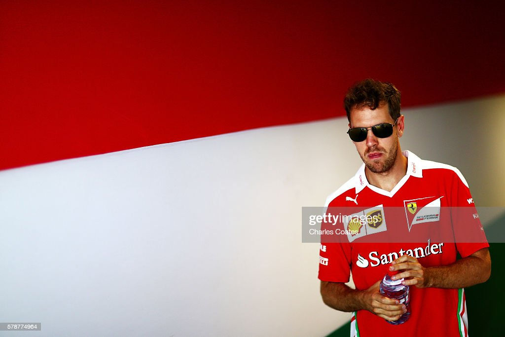 Sebastian Vettel of Germany and Ferrari walks in the Paddock during practice for the Formula One Grand Prix of Hungary at Hungaroring on July 22, 2016 in Budapest, Hungary.