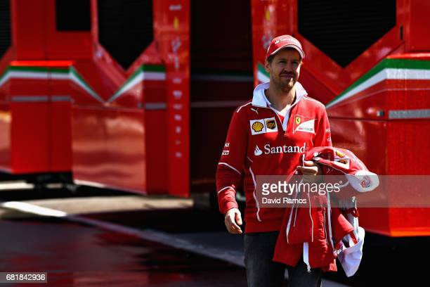 Sebastian Vettel of Germany and Ferrari walks in the Paddock during previews for the Spanish Formula One Grand Prix at Circuit de Catalunya on May 11...