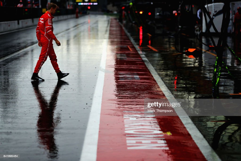 Sebastian Vettel of Germany and Ferrari walks in the Pitlane during qualifying for the Formula One Grand Prix of Italy at Autodromo di Monza on September 2, 2017 in Monza, Italy.