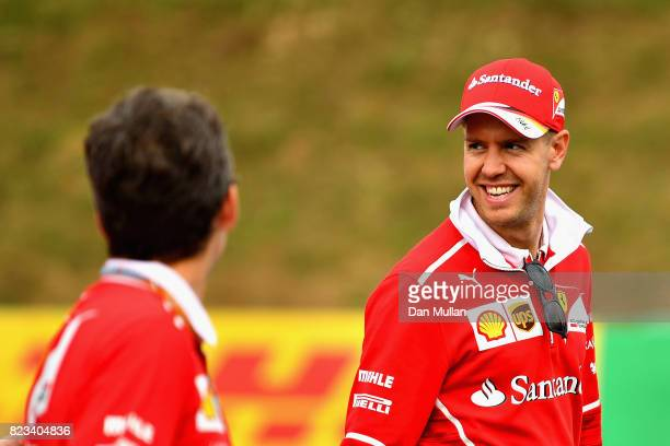 Sebastian Vettel of Germany and Ferrari walks the circuit with his engineers during previews ahead of the Formula One Grand Prix of Hungary at...