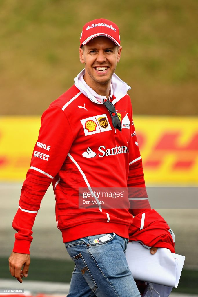Sebastian Vettel of Germany and Ferrari walks the circuit with his engineers during previews ahead of the Formula One Grand Prix of Hungary at Hungaroring on July 27, 2017 in Budapest, Hungary.