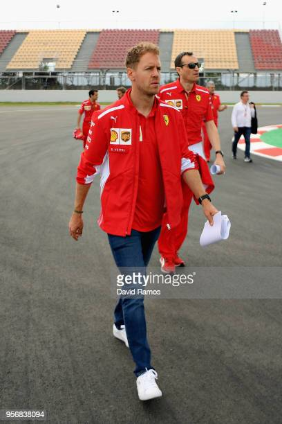 Sebastian Vettel of Germany and Ferrari walks the track with his engineers during previews ahead of the Spanish Formula One Grand Prix at Circuit de...