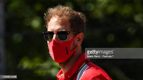 Sebastian Vettel of Germany and Ferrari walks the track with his team during previews for the F1 Grand Prix of Austria at Red Bull Ring on July 02,...