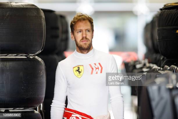 Sebastian Vettel of Germany and Ferrari walks to the garage during final practice for the Formula One Grand Prix of Brazil at Autodromo Jose Carlos...