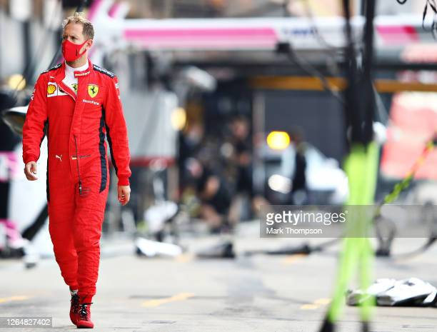 Sebastian Vettel of Germany and Ferrari walks to the grid before the F1 70th Anniversary Grand Prix at Silverstone on August 09, 2020 in Northampton,...