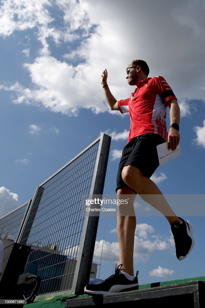 Sebastian Vettel of Germany and Ferrari waves to the crowd during previews ahead of the Formula One Grand Prix of Hungary at Hungaroring on July 26, 2018 in Budapest, Hungary.