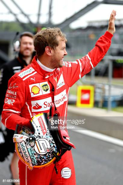 Sebastian Vettel of Germany and Ferrari waves to the crowd from the pitlane during final practice for the Formula One Grand Prix of Great Britain at...