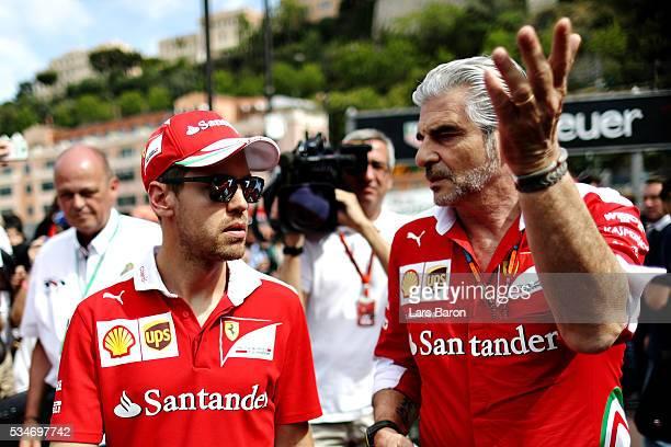 Sebastian Vettel of Germany and Ferrari with Ferrari Team Principal Maurizio Arrivabene in the Pitlane during previews to the Monaco Formula One...