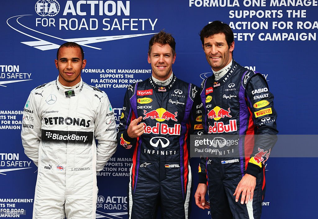 Sebastian Vettel (C) of Germany and Infiniti Red Bull Racing celebrates finishing first alongside second placed Mark Webber (R) of Australia and Infiniti Red Bull Racing and third placed Lewis Hamilton (L) of Great Britain and Mercedes GP following the weather delayed qualifying session for the Australian Formula One Grand Prix at the Albert Park Circuit on March 17, 2013 in Melbourne, Australia.