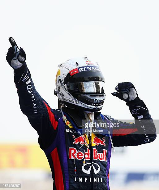 Sebastian Vettel of Germany and Infiniti Red Bull Racing celebrates in parc ferme after winning the Bahrain Formula One Grand Prix at the Bahrain...