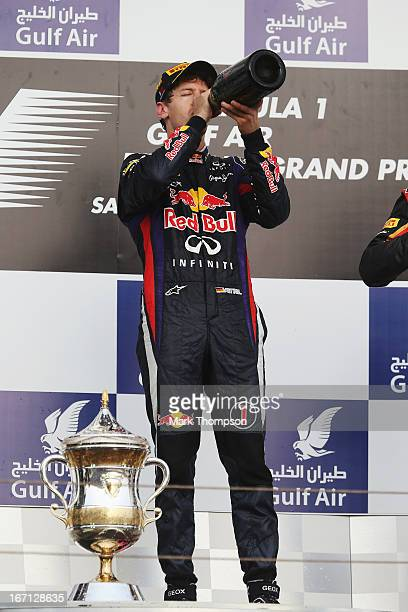 Sebastian Vettel of Germany and Infiniti Red Bull Racing celebrates on the podium after winning the Bahrain Formula One Grand Prix at the Bahrain...
