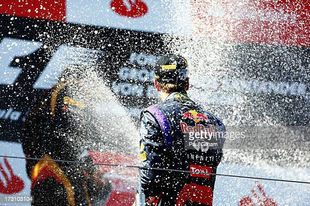 Sebastian Vettel of Germany and Infiniti Red Bull Racing celebrates on the podium after winning the German Grand Prix at the Nuerburgring on July 7,...