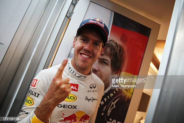 Sebastian Vettel of Germany and Infiniti Red Bull Racing celebrates after winning the German Grand Prix at the Nuerburgring on July 7 2013 in...