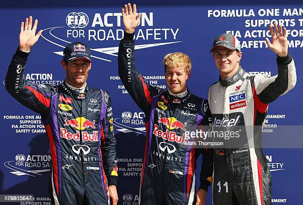 Sebastian Vettel of Germany and Infiniti Red Bull Racing celebrates finishing first alongside second placed Mark Webber of Australia and Infiniti Red...