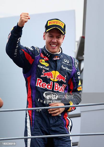 Sebastian Vettel of Germany and Infiniti Red Bull Racing celebrates on the podium after winning the Italian Formula One Grand Prix at Autodromo di...
