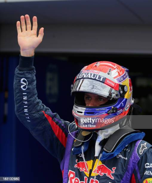 Sebastian Vettel of Germany and Infiniti Red Bull Racing celebrates in parc ferme after finishing first during qualifying for the Korean Formula One...