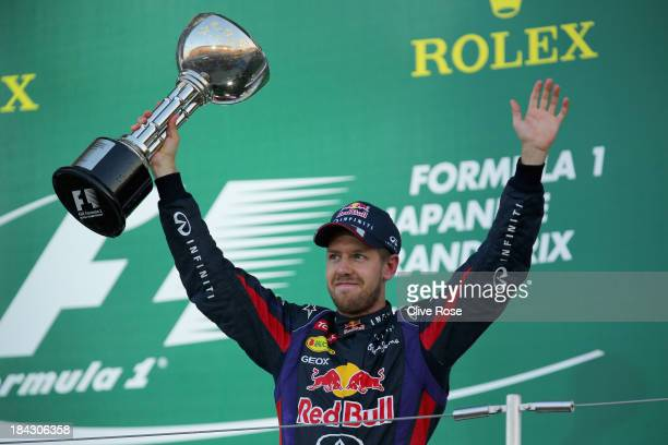 Sebastian Vettel of Germany and Infiniti Red Bull Racing celebrates on the podium after winning the Japanese Formula One Grand Prix at Suzuka Circuit...