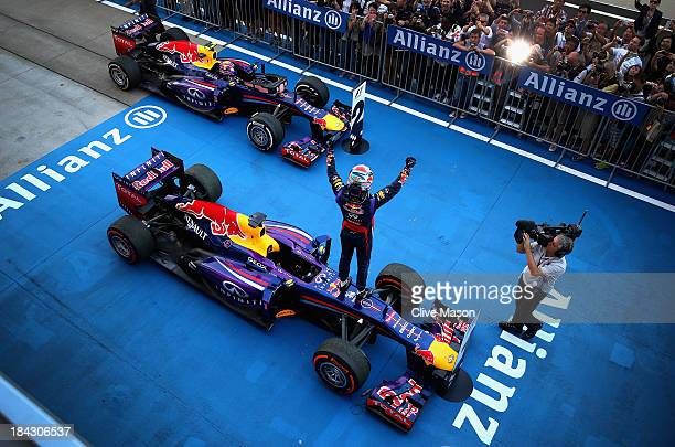 Sebastian Vettel of Germany and Infiniti Red Bull Racing celebrates in parc ferme after winning the Japanese Formula One Grand Prix at Suzuka Circuit...