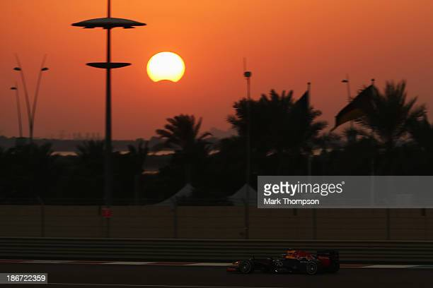 Sebastian Vettel of Germany and Infiniti Red Bull Racing drives as a rare hybrid solar eclipse takes place during the Abu Dhabi Formula One Grand...