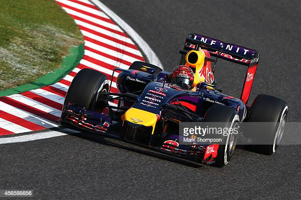 Sebastian Vettel of Germany and Infiniti Red Bull Racing drives during practice for the Japanese Formula One Grand Prix at Suzuka Circuit on October...