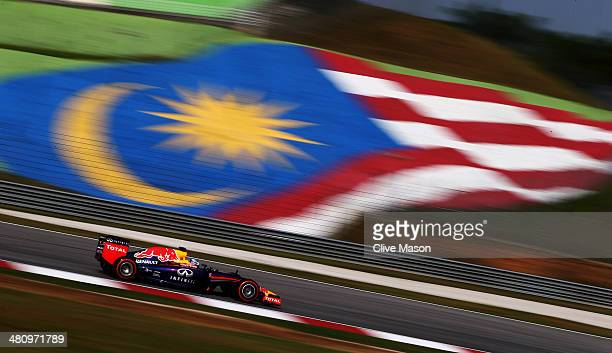 Sebastian Vettel of Germany and Infiniti Red Bull Racing drives during practice for the Malaysia Formula One Grand Prix at the Sepang Circuit on...