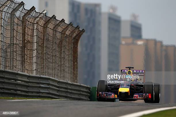 Sebastian Vettel of Germany and Infiniti Red Bull Racing drives during practice ahead of the Chinese Formula One Grand Prix at the Shanghai...