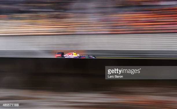 Sebastian Vettel of Germany and Infiniti Red Bull Racing drives during qualifying ahead of the Chinese Formula One Grand Prix at the Shanghai...
