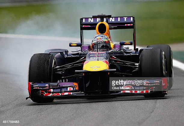 Sebastian Vettel of Germany and Infiniti Red Bull Racing drives on his way to winning the Brazilian Formula One Grand Prix at Autodromo Jose Carlos...