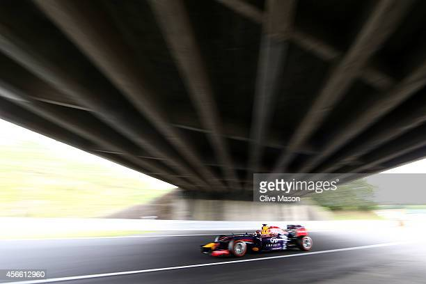 Sebastian Vettel of Germany and Infiniti Red Bull Racing drives during final practice for the Japanese Formula One Grand Prix at Suzuka Circuit on...