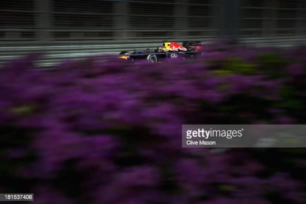 Sebastian Vettel of Germany and Infiniti Red Bull racing drives during the Singapore Formula One Grand Prix at Marina Bay Street Circuit on September...